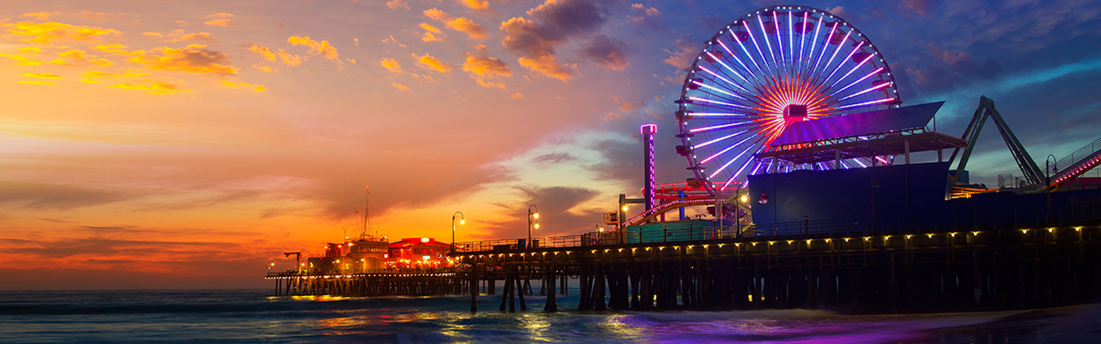 View of Santa Monica Pier at Night With Bright Colored Lights