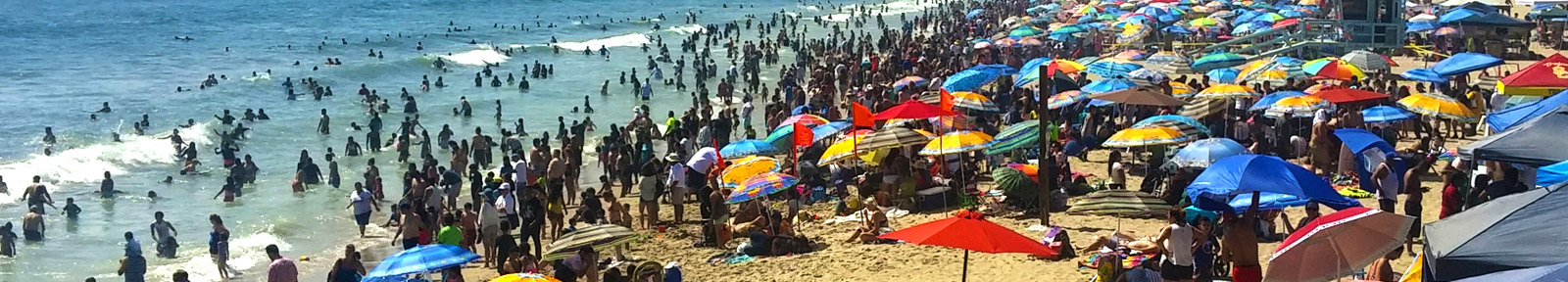 View of Santa Monica Beach Filled with People and Umbrellas - Par Commerial Brokerage - The Westside Specialist