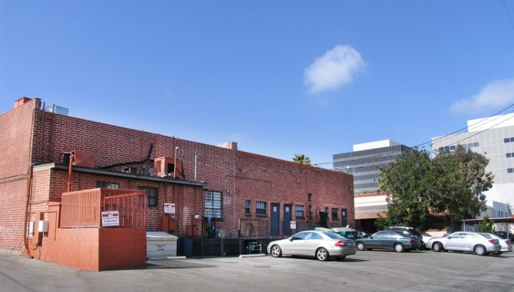 Rear Building and Parking Lot View of Premier Retail Building Sold at 2624 and 2632 Wilshire Boulevard, Santa Monica, CA 90403