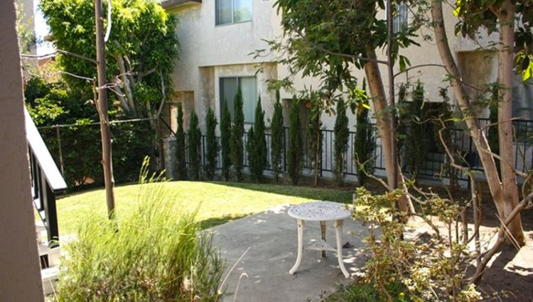 Exterior Courtyard View of 5-Unit Apartment Building at 737 Eucalyptus Drive, El Segundo, CA 90245