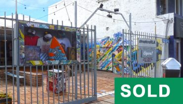 Outdoor Gated Tented Bazaar Space at 2912 Main Street, Santa Monica, CA 90405, Sold by Par Commercial Brokerage