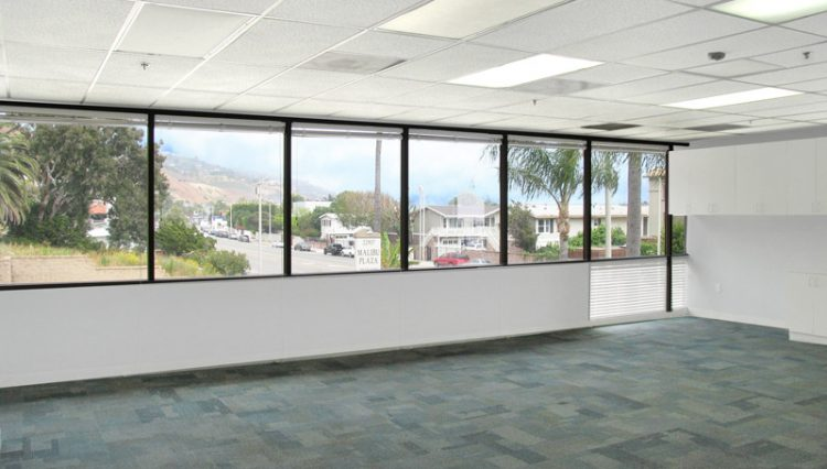 White office space with windows that look out to Malibu Pier for Lease at 22917 Pacific Coast Highway, Malibu, CA 90265